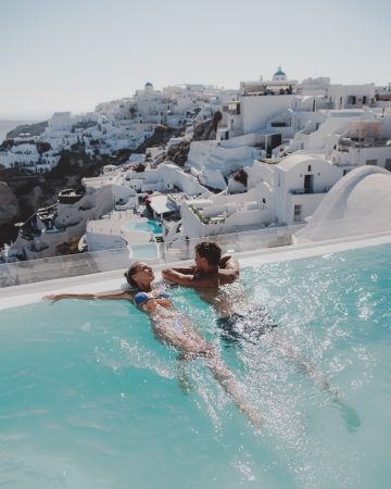Couple in an infinity pool in Andronis Luxury Suites room in Santorini