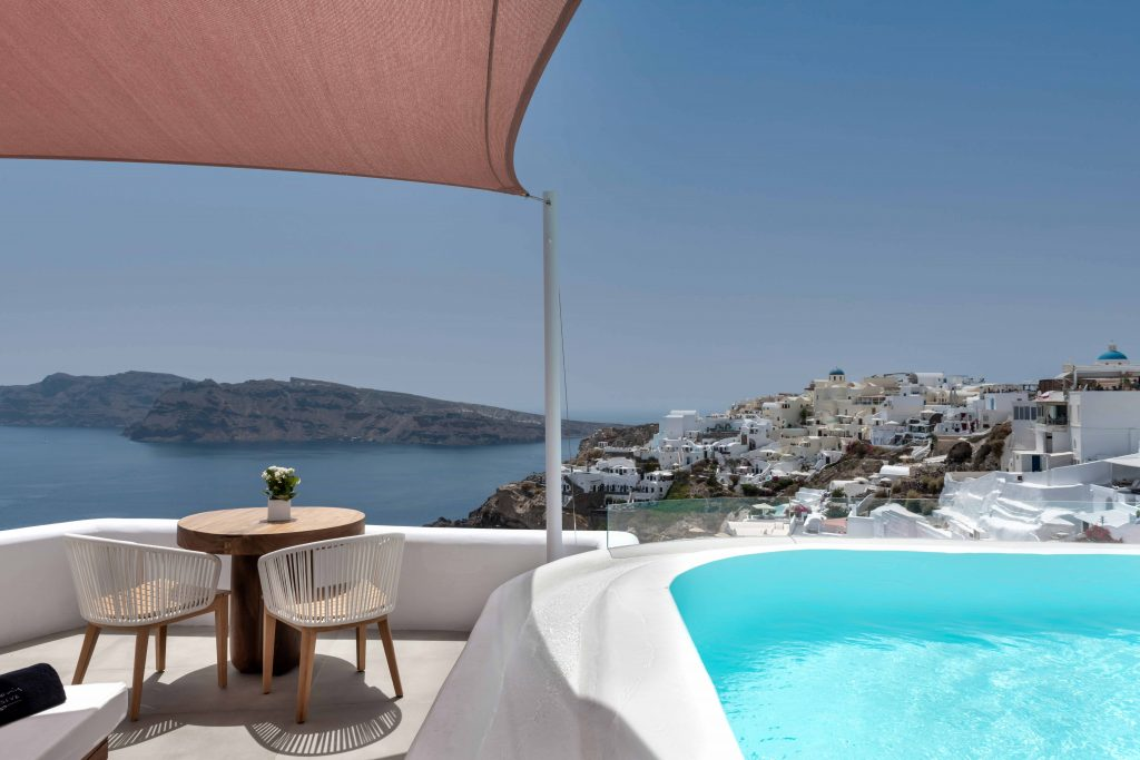 Andronis Luxury Suites' Infinity Pool and caldera view